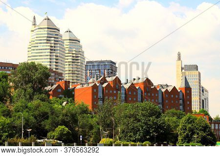 Beautiful Spring And Summer View Of Big City, Buildings, White Skyscrapers And A Park In The Dnipro