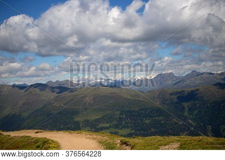 Scenery Of The Italian Dolomites, Forests, Rock Massifs With Snow On A Background Of Blue Sky With C