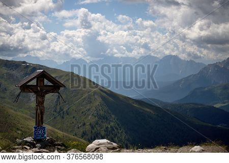 Scenery Of The Italian Dolomites, Mountain Massifs With Snow On A Background Of Blue Sky With Clouds