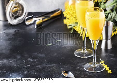 Mimosa Alcohol Cocktail With Orange Juice And Cold Dry Champagne Or Sparkling Wine In Glasses, Gray
