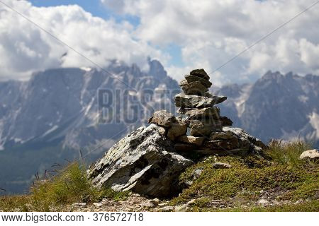 Scenery Of Italian Dolomites, Small Stone Mounds On The Background Of Rock Massifs With Blue Sky And