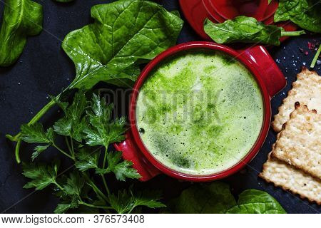 Useful Healthy Spinach Soup In Red Saucepan On A Dark Background, The View