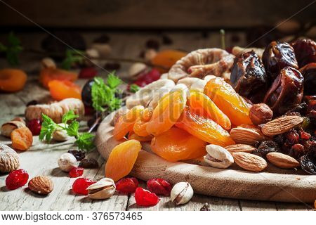 Dried Apricots, Set Of Nuts And Dried Fruits, Vintage Wooden Background, Selective Focus