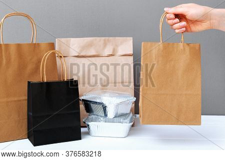 Food Delivery Service. Brown Craft Paper Bag Package In Female Hand. Delivery Mock Up Packaging. Foo