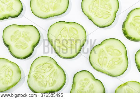 Cucumber Slices Pattern Isolated On White Background. Cucumis Sativus Background