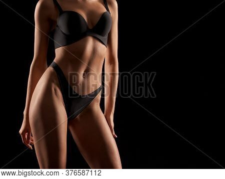Front Crop Of Incognito Sexy Caucasian Female Model Wearing Black Lingerie Standing, Isolated On Bla