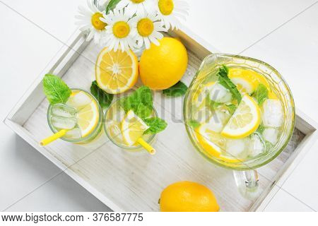 Two Glasses Of Foggy And A Decanter With Homemade Lemonade On A Tray. Cooling Drink In The Hot Summe