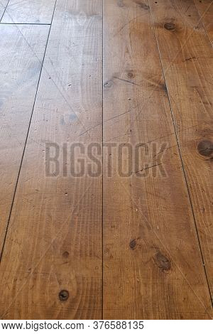 Wooden Floors Damaged By Traces Of Shoes: Scratches And Black Stripes.