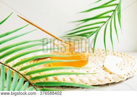 Sugar Paste To Remove Hair On A Wooden Stick. Sugaring Paste In A Glass Jar On Wicker Bedding. An Al