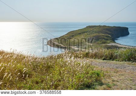 View Of The Dawn Over The Sea Of Japan. The Beginning Of Autumn At Cape Vyatlin, Vladivostok. The Ro