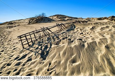 Beautiful Calm View Of Nordic Sand Dunes And Protective Fences At Curonian Spit, Nida, Klaipeda, Lit