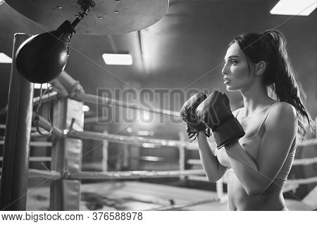 Close Up Of Brunette Woman Wearing Black Boxing Gloves. Young Attractive Female Fighter With Perfect