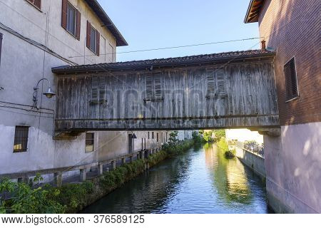 Gorgonzola, Milan,  Lombardy, Italy: Canal Of Martesana And Old Buildings Along The Cycleway. Wooden