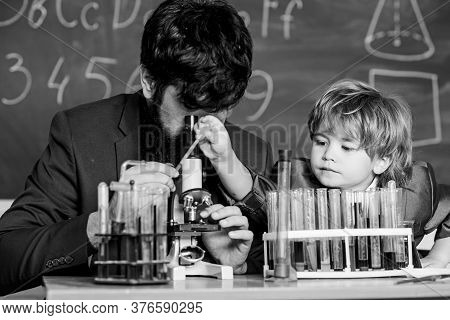 Study Educational Activity Through Experience. I Love Study In School. Teacher And Boy In Chemical L