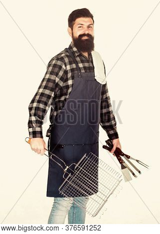 Tips For Cooking Meat. Barbecue Season. Bearded Hipster Wear Apron For Barbecue. Roasting And Grilli