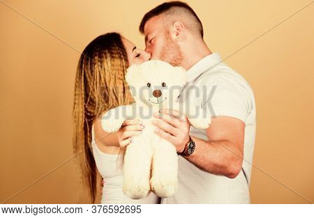 Soft Toy Teddy Bear Gift. Pregnancy Concept. Man And Woman Couple In Love. Future Parents. Family Lo
