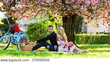 Happy Loving Couple Relaxing In Park With Food. Enjoying Their Perfect Date. Couple In Love Picnic D