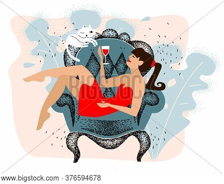 Hedonism. Girl In Red Dress Is Resting And Drinking Wine. Relax At Home On The Armchair, The Hedonis