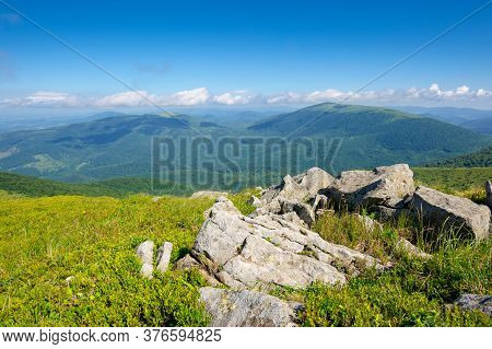 Mountain Meadow In Summer Landscape. Blue Sky With Fluffy Clouds. Beautiful Summer Scenery On A Sunn