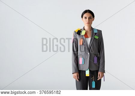 Businesswoman With Labels On Formal Wear Standing Isolated On White, Gender Inequality Concept