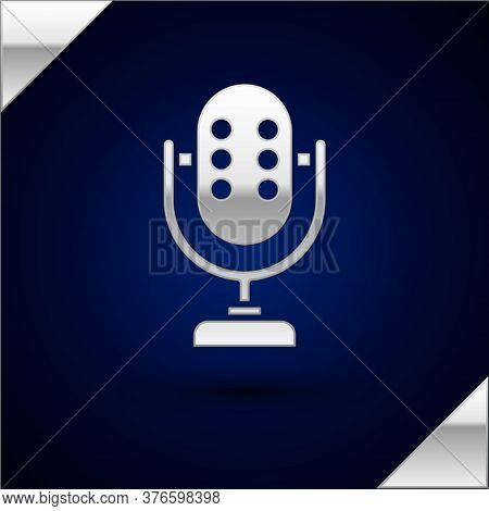 Silver Microphone Icon Isolated On Dark Blue Background. On Air Radio Mic Microphone. Speaker Sign.