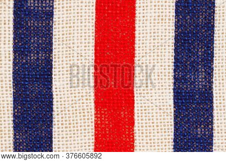 Red, White And Blue Grunge Burlap Textured Weave Material Background With Copy Space For American Me