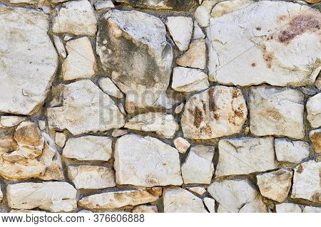 Masonry Rock Wall Texture. Stones In Foundation Of Old Castle. Stone Wall Background For Design Or I