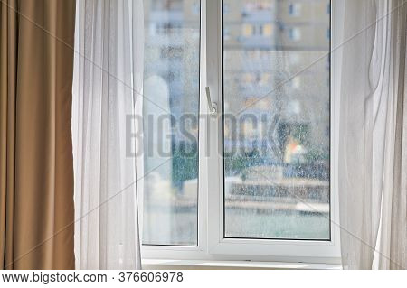 Dirty Window In Apartment. Unwashed Dusty Glass, City Street View Background. Unclean Double Glazed