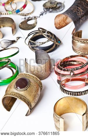 Variety of traditional bangles and bracelets over white background
