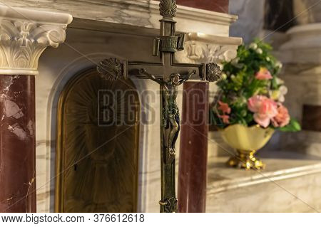 Haifa, Israel, July 10, 2020 : The Bronze Crucifix Stands In The Main Hall Of The Stella Maris Monas