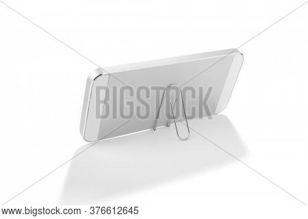 Lifehack; binder clip as a smart phone stand isolated on white background.