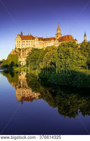 View Of The Hohenzollern Castle Sigmaringen At Sunset With Reflections In The Danube River