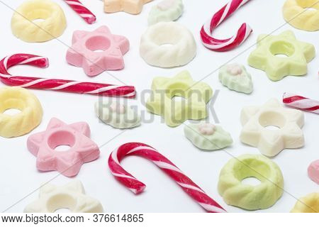 Candy Canes And Meringue Candy On A White Isolated Background Multiple Colored Green / Orange / Whit