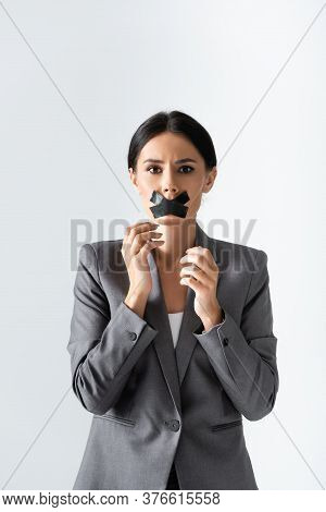 Businesswoman With Scotch Tape On Mouth Looking At Camera Isolated On White, Gender Inequality Conce