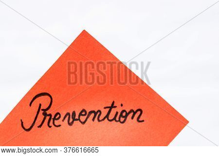 Prevention Handwriting Text Close Up Isolated On Orange Paper With Copy Space. Writing Text On Memo