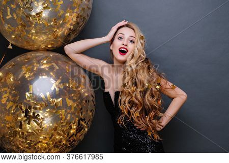 Portrait Beautiful Young Woman In Black Luxury Dress, With Long Curly Blonde Hair, Red Lips, With Bi
