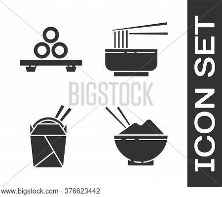 Set Rice In A Bowl With Chopstick, Sushi On Cutting Board, Asian Noodles In Paper Box And Chopsticks