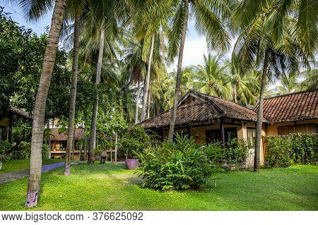 Vietnam, Mui Ne, November, 2016 - Bungalow On The Seahorse Resort & Spa Hotel Territory In A Tropica