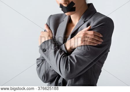Cropped View Of Businesswoman With Scotch Tape On Mouth Standing With Crossed Arms Isolated On White