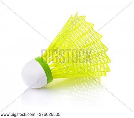Yellow plastic badminton shuttlecock isolated on white