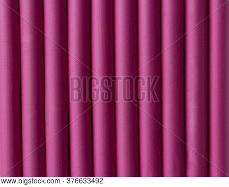 Abstract Background Of Pink Rubber Pipes. Pink Rubber Tubes For Decoration. Pink Hair Curlers, Close