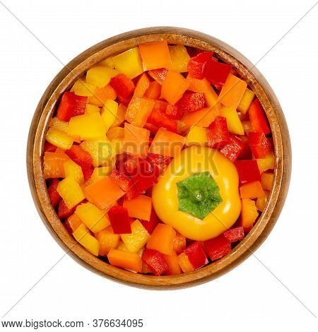 Bell Pepper Head And Diced Pods In Wooden Bowl. Sweet Pepper, Capsicum, Also Paprika, Cut In Colorfu