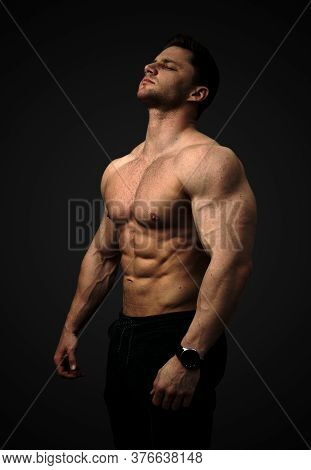 Aesthetic, Muscular Man Shirtless. Concentration On Goals, Motivation, Thinking. A Strong Six-pack B