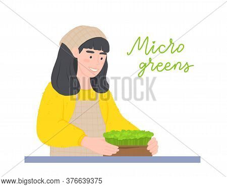 Happy Girl With A Microgreens Boxes. Farming Superfood At Home. Woman With A Watering Can. Micro Gre