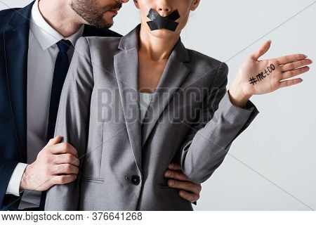 Cropped View Of Businessman Molesting Businesswoman With Scotch Tape On Mouth Showing Hand With Me T