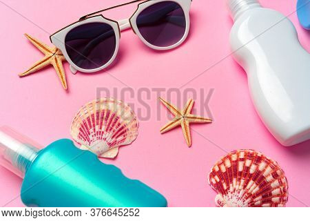 Sunglasses And Sunblock Cream Close Up On Paper Background