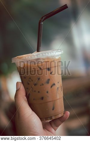 Iced Mocha Hold By Hand Take Away Glass. Close Up