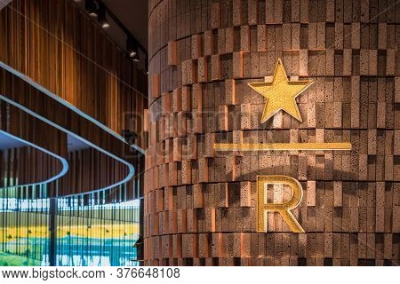 Bangkok, Thailand - June, 2020 :  Starbucks Logo With R And Star Icon And Brand Shop In On June 14,