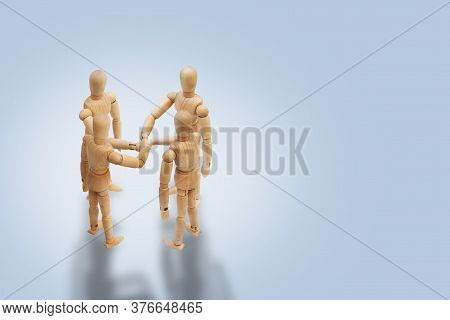 Business Unity And Teamwork Concept : Group Of Wooden Figure Toys Putting Stack Their Hands Together