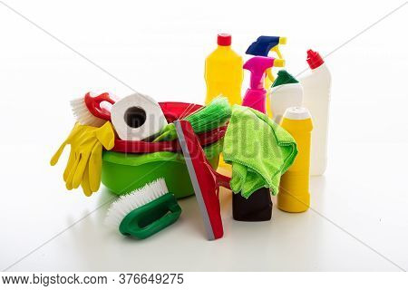 Cleaning Supplies And Bowls Isolated Against White Background.